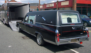 Cadillac Hearse being loaded for a funeral director